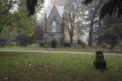 Mausoleum in an Old Pioneer Cemetery in fog Royalty Free Stock Photography