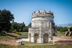 Mausoleum of Theodoric the Great in Ravenna, Italy against clear blue sky and greenery royalty free stock images