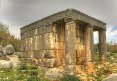 A Mausoleum Tomb in Turkey. Mausoleum tomb of Queen Aba in Kanytelleis ancient city in Mersin, Turkey Royalty Free Stock Photos
