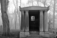 Mausoleum in a very foggy graveyard. Royalty Free Stock Image