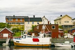 Ships moored between buildings Stock Photography