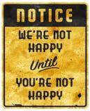 Mauvais slogan non heureux de devise de caverne d'homme de signe de service photo libre de droits