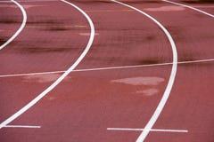 Mauvais temps de voie sportive courante, humide photo libre de droits