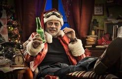 Mauvaise Santa ayant mauvais Noël Image stock