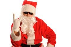 Mauvaise Santa effectue le signe de diable images libres de droits