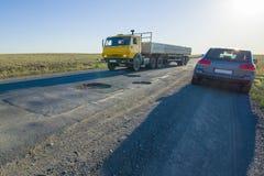 Mauvaises routes exigeant la réparation Photographie stock