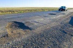Mauvaises routes exigeant la réparation Photographie stock libre de droits