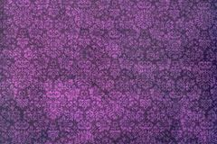 A wallpaper of a repeat botanic pattern. A mauve background of abstract damask flowers and leaves Stock Photography