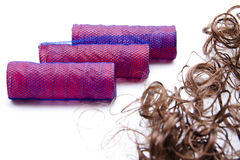 Mauve curler and hairpiece. On white background Stock Photography