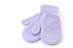 Mauve mitts. Mauve baby mitts isolated on white background with copy space, in horizontal format Royalty Free Stock Photography