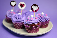 Mauve purple decorated cupcakes - closeup horizontal.