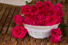 Mauve roses in basket Stock Image