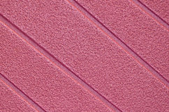 Mauve Surface. Mauve rough surface with diagonal ridges for background Royalty Free Stock Images