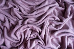 Mauve viscose fabric with folds. From above Royalty Free Stock Photos