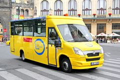 Mave (Iveco Daily). PRAGUE, CZECH REPUBLIC - JULY 21, 2014: Yellow sightseeing bus Mave (Iveco Daily) at the city street Stock Image