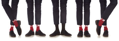 Maverick. Man leg in suit and red socks, isolated on white Royalty Free Stock Photography