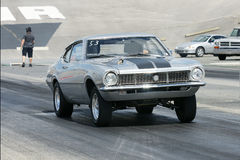 Drag car start. Picture of silver maverick during start at drag race Royalty Free Stock Images