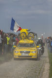 Mavic's Car- Paris Roubaix 2014. Carrefour de l'Arbre,France-April 13,2014: Yellow technical Mavic's vehicle following the cyclists on the famous dusty Royalty Free Stock Photos