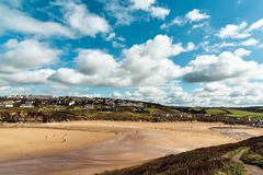 Mawgan Porth beach Newquay Cornwall. A long sandy beach with white clouds above it, Mawgan Porth, Newquay, Cornwall, England stock images