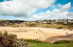 Mawgan Porth beach and settlement in Newquay. North Cornwall, England during the start of autumn stock photography