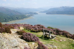 Mawwdach Estuary. A view along the Mawwdach estuary in Barmouth west Walse witha seat in the foreground Stock Photos