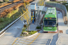 MAX Bus Rapid Transit. FORT COLLINS, CO, USA - SEPTEMBER 16 2014: MAX bus at stop. MAX Bus Rapid Transit serves major activity and employment centers throughout royalty free stock image