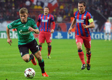 Max Meyer and Alexandru Bourceanu during UEFA Champions League game Stock Photos
