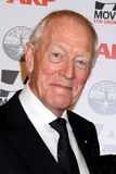 Max Von Sydow. LOS ANGELES - FEB 6:  Max von Sydow, Wife Catherine Brelet arrives at the AARP's 11th Annual Movies For Gownups Awards at Beverly Wilshire Hotel Royalty Free Stock Image