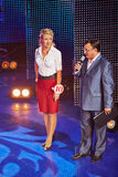 Maxim Aksenov and participant at number 10 on stage. MOSCOW - AUG 3: General director of AHA company, emcee of competition Beauty of Russian Railways Maxim Royalty Free Stock Images