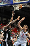 Maxim Grigoriev knocks the ball from the hands of an opponent Royalty Free Stock Image