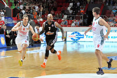 Maxim Grigoriev takes the ball from Ramel Curry Royalty Free Stock Photo