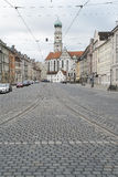 Maximilian street with church St Ulrich and Afra in Augsburg Stock Photos