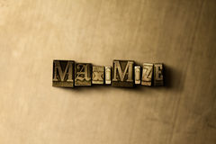 MAXIMIZE - close-up of grungy vintage typeset word on metal backdrop. Royalty free stock - 3D rendered stock image. Can be used for online banner ads and royalty free stock image