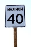 Maximum 40 Sign. A road sign indicating 40 km/mph speed limit stock photos