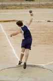 Maximum Effort 1. A competitor in the men's shot put event during a college track meet Stock Photo