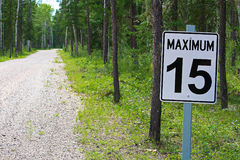 A maximum 15 speed limit sign along a gravel road Stock Images