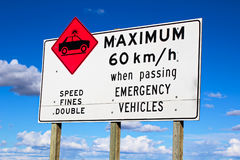 Maximum speed while passing emergency vehicles sign Royalty Free Stock Photos