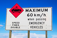 Maximum speed while passing emergency vehicles sign Royalty Free Stock Photo