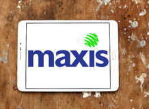 Maxis Communications logo. Logo of Maxis Communications company on samsung tablet on wooden background. Maxis is a communications service provider in Malaysia Stock Images