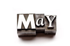 May. The month of May done in letterpress type on a white paper background