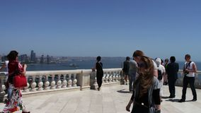 May 9,2017 - Azerbaijan, Baku: tourists walk and take pictures at the observation deck with a view of a Caspian Sea and stock video footage