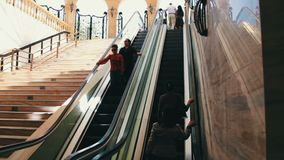 MAY 9, 2017, BAKU, AZERBAIJAN: People descend and climb the escalator in metro stock video footage