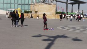 MAY 9, 2017, BAKU, AZERBAIJAN: People stroll in square of Baku, a crowd of people walk the streets of the city.People stock video footage