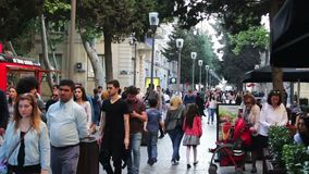 MAY 9, 2017, BAKU, AZERBAIJAN: People stroll in square of Baku, a crowd of people walk the streets of the city. stock footage