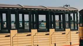 MAY 9, 2017, BAKU, AZERBAIJAN: A tourist locomotive is passing by people are stroll in square of Baku, a crowd of people stock video