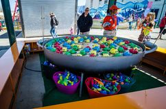 A bobbing fishing carnival game on the Coney Island boardwalk awaits customers on an early spring. Day stock photography
