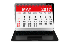 May 2017 calendar over laptop screen. 3d rendering. 2017 year calendar. May calendar over laptop screen on a white background. 3d rendering Stock Photography