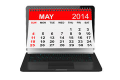 May calendar over laptop screen. 2014 year calendar. May calendar over laptop screen on a white background Royalty Free Stock Image