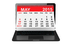 May 2015 calendar over laptop screen. 2015 year calendar. May calendar over laptop screen on a white background Stock Photography