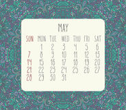 May 2017 calendar. May 2017 vector calendar over blue lacy doodle hand drawn background, week starting from Sunday stock illustration